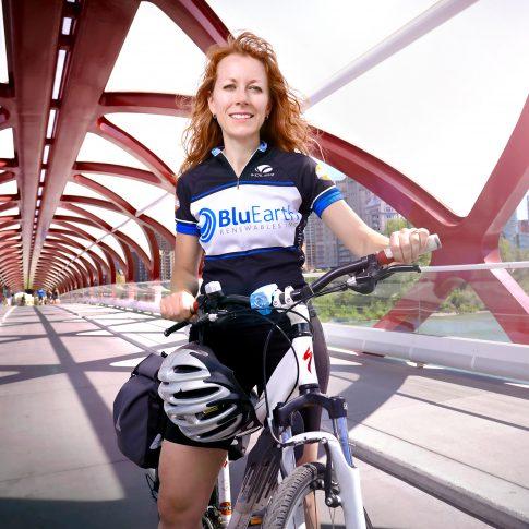 woman cycling - peace bridge - editorial - harderlee