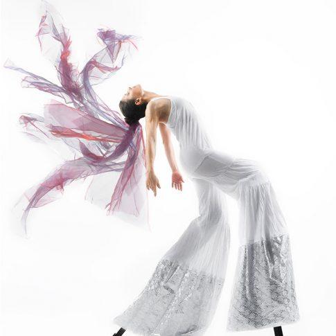 stilt dancer on white - performing arts - harderlee